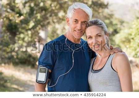 sport fitness couple relaxing after training outdoor stock photo © deandrobot