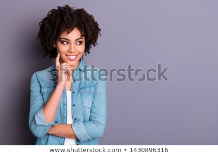 Thoughtful beautiful african young woman thinking and touching her temple Stock photo © deandrobot