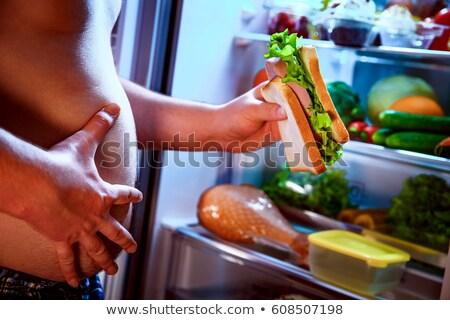 Faim homme sandwich mains permanent Photo stock © cookelma