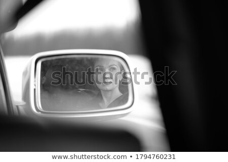 Female eyes focusing on road, reflection in vehicle rearview mir Stock photo © stevanovicigor