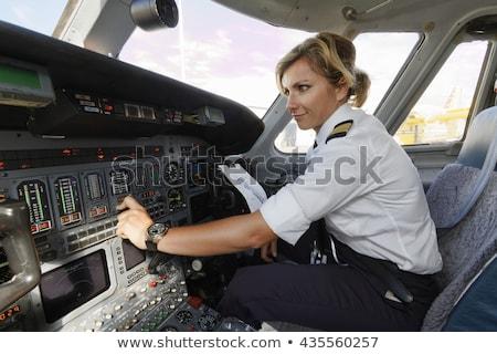 Woman pilot and airplane Stock photo © artfotodima