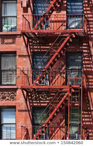 Stockfoto: Old Iron Fire Escape Rescue Ladders At Old Houses