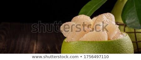 Rebanadas verde pomelo dos hojas blanco Foto stock © Digifoodstock