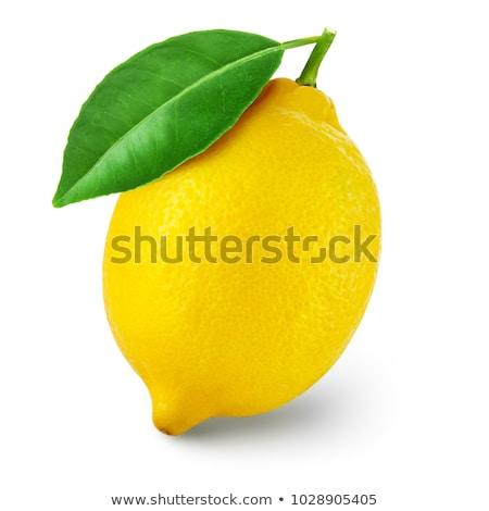 fresh lemons with lemon leaves stock photo © yelenayemchuk