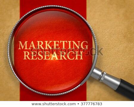 marketing research through loupe on old paper stock photo © tashatuvango