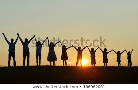 Children holding hands on beach Stock photo © IS2