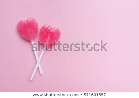 Cuore lollipop shot femminile mano Foto d'archivio © LightFieldStudios