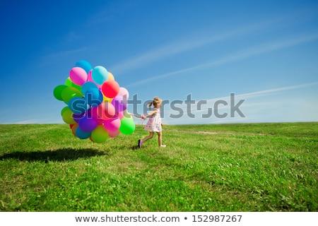 Nő sétál léggömbök mező nyár szín Stock fotó © IS2
