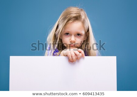 adorable little girl in purple dress holds empty poster and phone handset stock photo © traimak