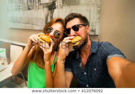 Photo stock: Couple Eating Kissing Outdoors