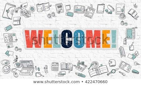 Welcome Concept. Multicolor on White Brickwall. Stock photo © tashatuvango