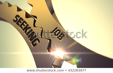 Job Seeking on Golden Metallic Cog Gears. Stock photo © tashatuvango