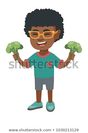 Pequeno africano menino risonho brócolis Foto stock © RAStudio