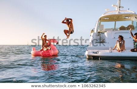 Jókedv csónak nő fiatalság női vakáció Stock fotó © IS2