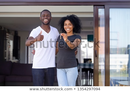 couple standing outside house with real estate sign stock photo © monkey_business