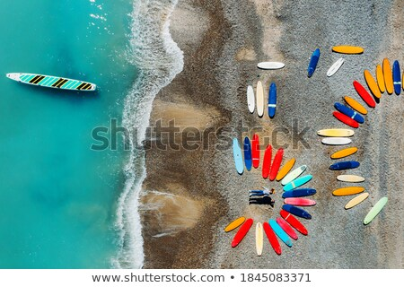 Couple lying on surfboards in the water. Stock photo © IS2