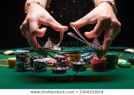 Pôquer ganhar homem mãos cartas de jogar Foto stock © psychoshadow