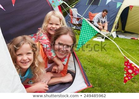 Négy személy sátor táborhely fa erdő pár Stock fotó © IS2