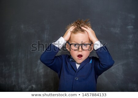 Portrait of surprised girl with head in hands against maths doodle Stock photo © wavebreak_media