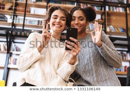 Girl phoning in the classroom Stock photo © wavebreak_media