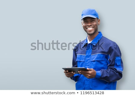 young african electrician holding mobile phone stock photo © andreypopov