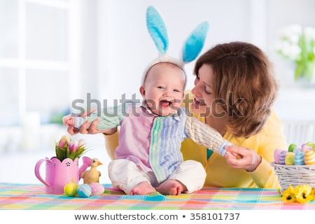 baby girl with parents playing with toy rabbit Stock photo © dolgachov