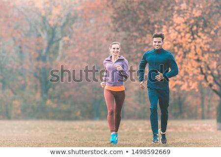 Couple in wonderful fall landscape running for better fitness Stock photo © Kzenon