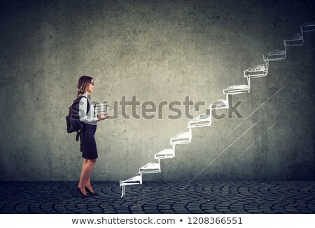 student with books standing on the stairs of education leading to success  Stock photo © ichiosea