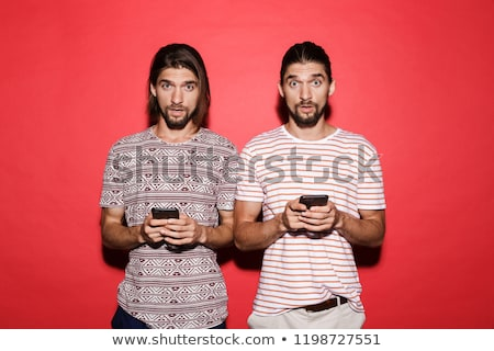 portrait of a two young cheerful twin brothers stock photo © deandrobot