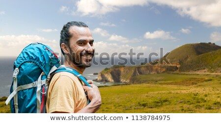 close up of man with backpack over big sur coast Stock photo © dolgachov