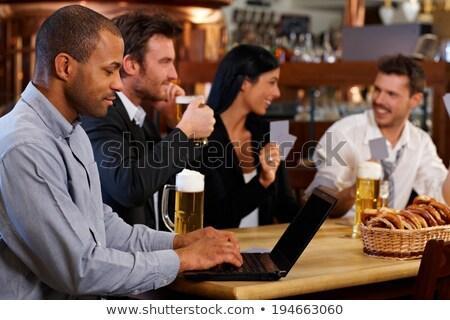 Hombre cuaderno potable cerveza bar pub Foto stock © dolgachov