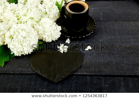 Cup of coffee with bouquet flower hydrangea and slate heart Stock photo © Illia