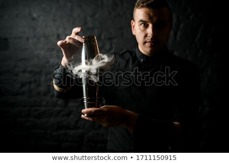 Portrait of bartender holding shaker Stock photo © Kzenon