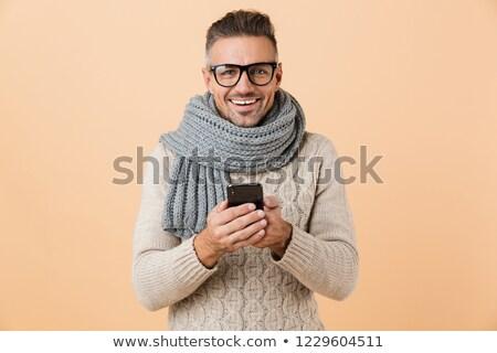 Ritratto eccitato uomo maglione sciarpa isolato Foto d'archivio © deandrobot