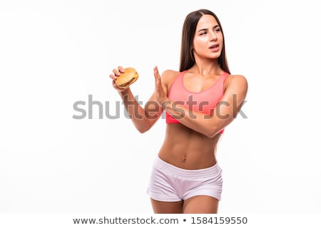 Image of caucasian overweight woman in tracksuit doing stop gest Stock photo © deandrobot