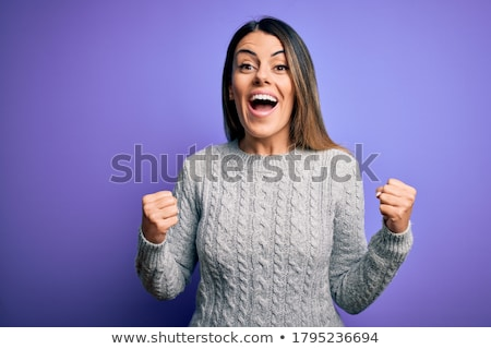 Cheerful young woman wearing sweater standing Stock photo © deandrobot
