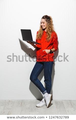 full length photo of lovely woman 20s wearing red sweatshirt jum stock photo © deandrobot