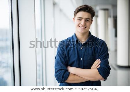 fiatalember · mosolyog · jóképű · kék · póló · vidám · arc - stock fotó © ajn