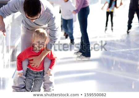 children skating rink playing together in winter stock photo © robuart
