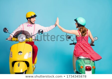 Back view of young lovely couple riding on retro scooter Stock photo © deandrobot