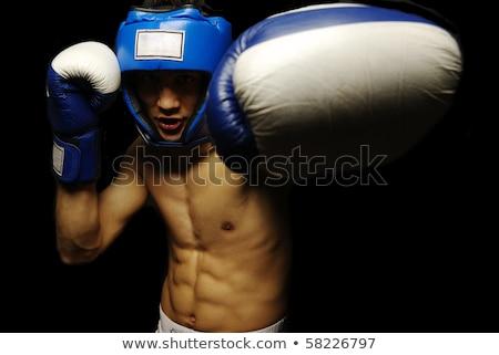 Jonge geconcentreerde sterke sport man bokser Stockfoto © deandrobot