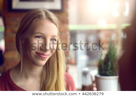 Young attractive blond woman listening intently Stock photo © Giulio_Fornasar