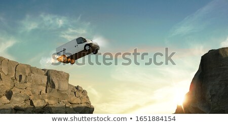 fast delivery van with burning tires stock photo © andreasberheide