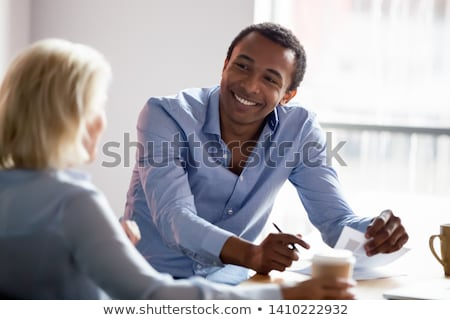 Two young happy designers discussing new creative ideas Stock photo © pressmaster