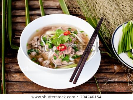 gekruid · vlees · soep · eetstokjes · tabel - stockfoto © galitskaya