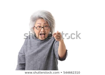 portret · glimlachend · oude · vrouw · wijzend · vinger · geïsoleerd - stockfoto © dolgachov