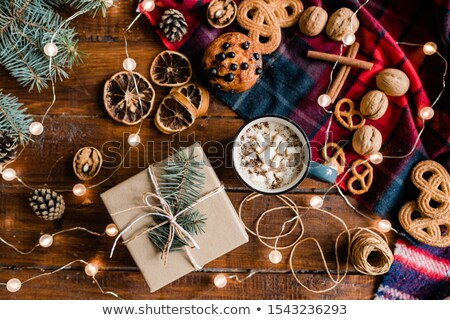 Giftbox, hot drink, pinecones, cookies, walnuts, threads, conifer and garlands Stock photo © pressmaster