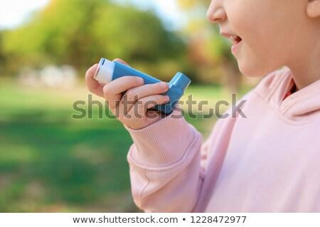 Kéz asztma orvosi kék száj fehér Stock fotó © Lopolo