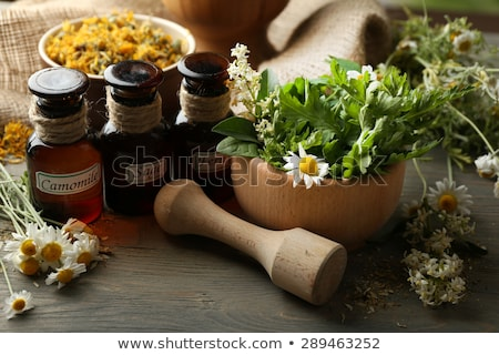 Oil and Natural medicine, wooden table background Stock photo © JanPietruszka