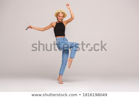 Attractive laughing young woman wearing a top hat Stock photo © Giulio_Fornasar